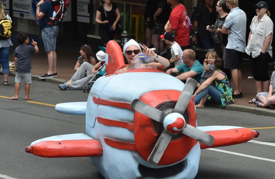 Bella Bloomfield plays pilot in a parade float.