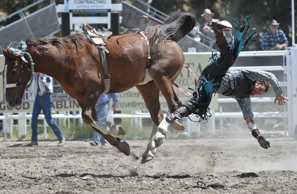 Gore's Nathan Keown departs his bronc during the open bareback division at last year's event.