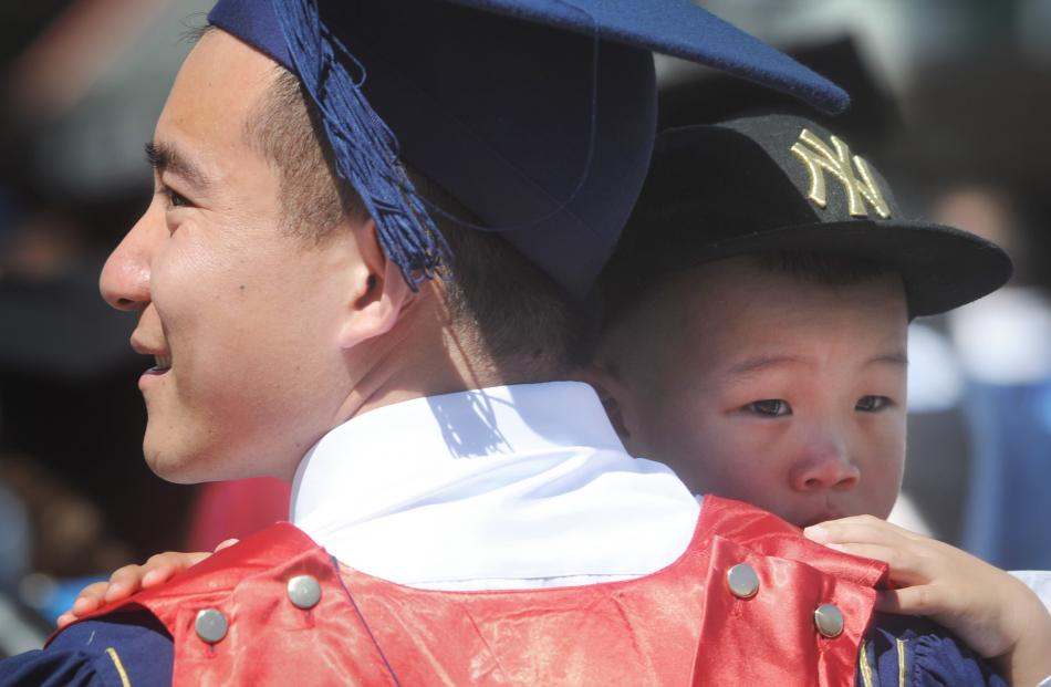 Otago Polytechnic sales and marketing graduate Leo Li with his 3-year-old godson William Sun.