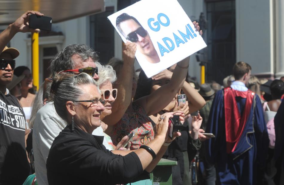 Family and friends support Adam Jones during the graduation parade  in George St yesterday....