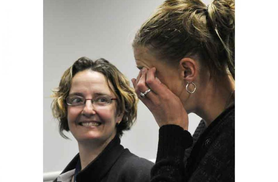 Nicky Fairbairn looks on as fellow neurosurgery survivor Casey Coombes wipes a tear after hearing...