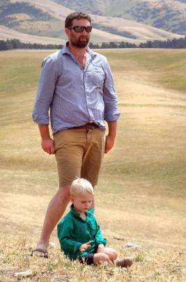Gimmerburn farmer Simon Paterson and younger son Bede (3) during a field day at their property.