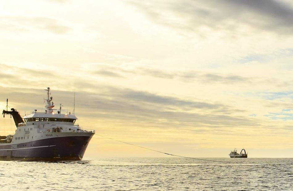 San Enterprise heads back out to sea as the tug Arihi takes Rehua under tow. PHOTOS: STEPHEN...