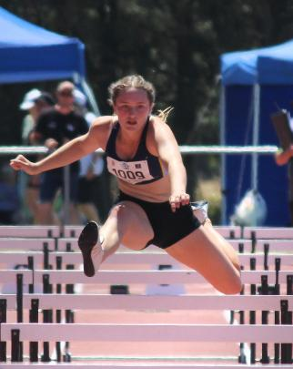 Tara McNally (15) heads for the finish line during the 80m hurdles.