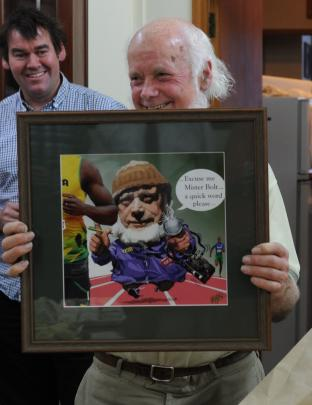 Former Otago Daily Times sports reporter Alistair McMurran holding a Murray Webb caricature on his last day at the ODT. Photos: ODT files