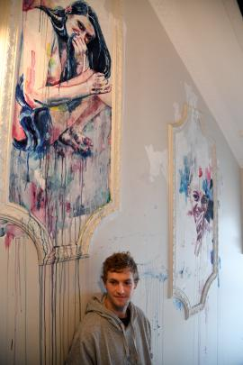 Tyler Kennedy Stent takes stock of his handiwork in the hallway of the Commerce Building at the...