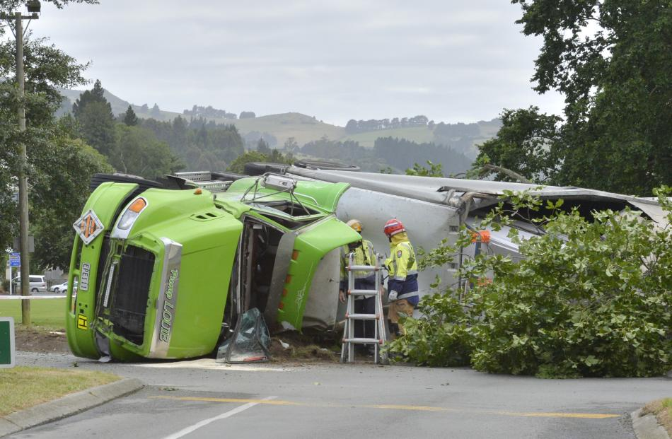 A truck on its side at the intersection of Pine Hill Rd and Great King St. Photo: Gerard O'Brien