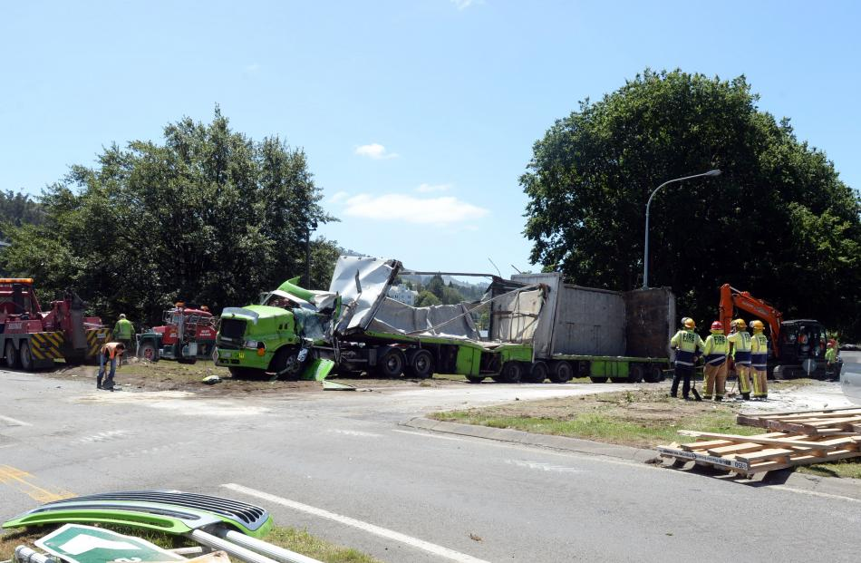 Tow trucks work to move the wreckage. Photo: Linda Robertson