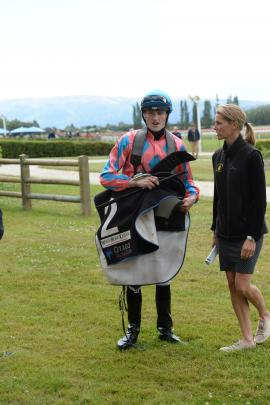 Mosgiel jockey Jacob Lowry and trainer Claire Anderton share some down time after a race at the Interislander Summer Festival at Wingatui Racecourse yesterday. Photos: Linda Robertson