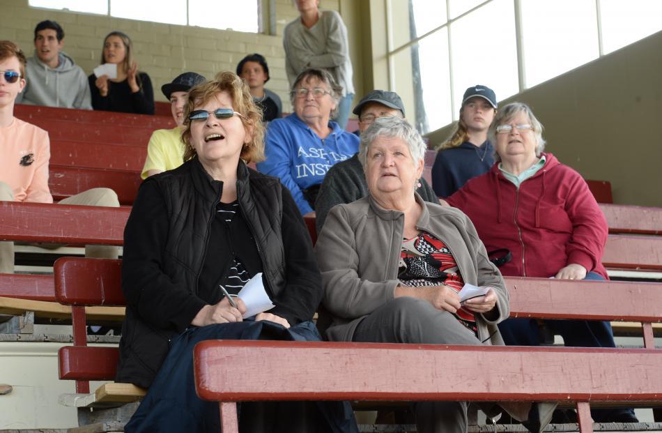 Sue Anderton (left), of Mosgiel, and Cathy Matthews, of Dunedin, watch race 5 at Wingatui Racecourse yesterday.