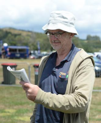Tim Webb of Dunedin studies his race book at The Interislander Summer Festival.