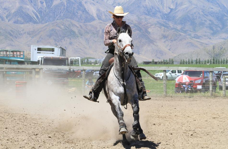 Angie Meehan, of Wanaka, competes in the open barrel race.