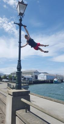 Jay Cameron (14) practises his ''parkour'' skills at the Steamer Basin wharf in Dunedin last...