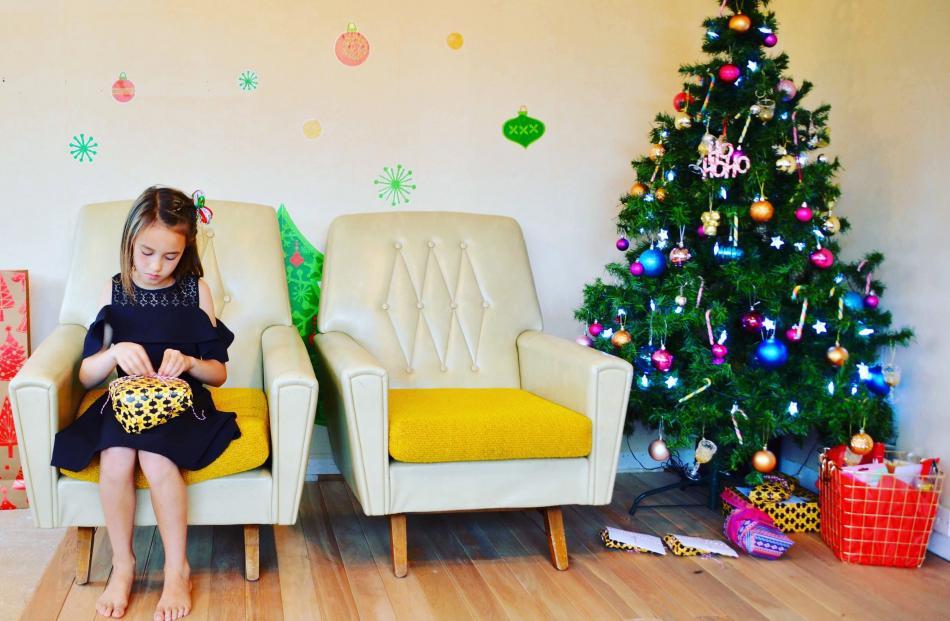 Bailey-Ray Chapman (8) opens a present on Christmas Day. Photo: Sarah Williams