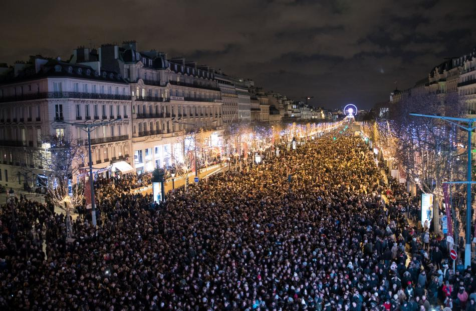 Crowds gather to celebrate the New Year along the Champs Elysees Avenue in Paris. Photo: Reuters