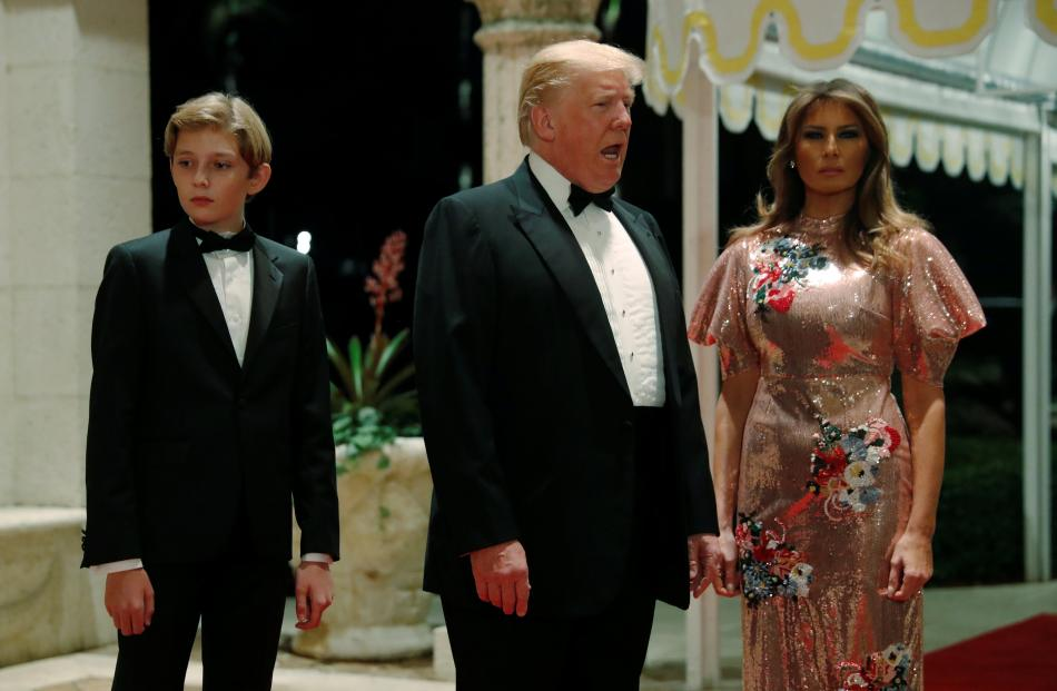 US President Donald Trump and first lady Melania Trump, with their son Barron, arrive for a New...