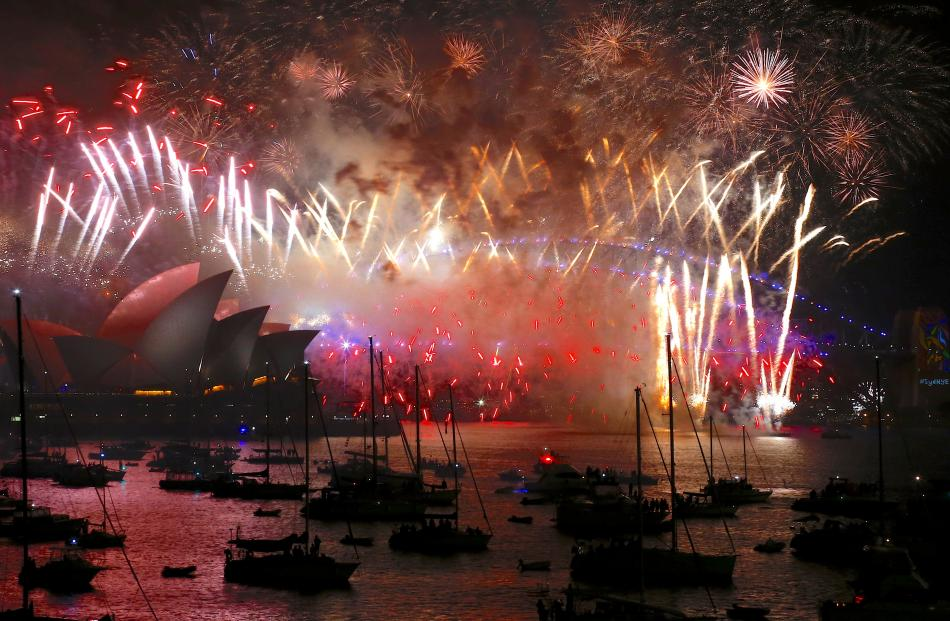 Fireworks light up the Sydney Harbour Bridge and Sydney Opera House during new year celebrations...