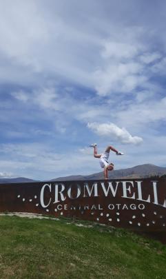 Brooke Soper (11) performs gymnastics on the Cromwell sign on December 27. Photo: Janal Johnston