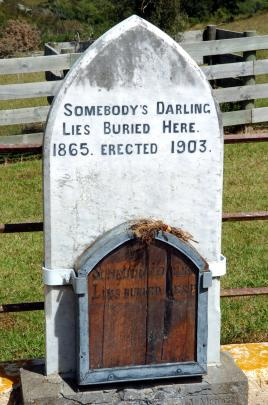 "William Rigney's original pine plaque for ""Somebody's Darling'' sits in front of the later marble headstone at Horseshoe Bend. Photo: Gerard O'Brien"