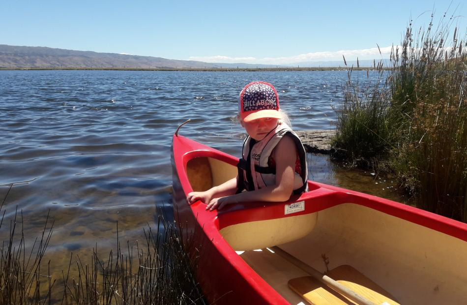 Lucy Bryant (7) waits to take a ride in a canoe near Patearoa, in Central Otago, on December 28. Photo: Craig Bryant