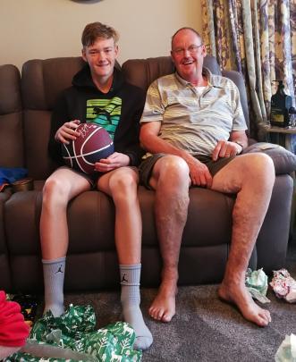 """`Poppa'' Geoff Davis, of Mosgiel, and grandson Mason Pringle (13), of Palmerston, compare the length of their legs on Christmas Day. Photo: Lois Davis"