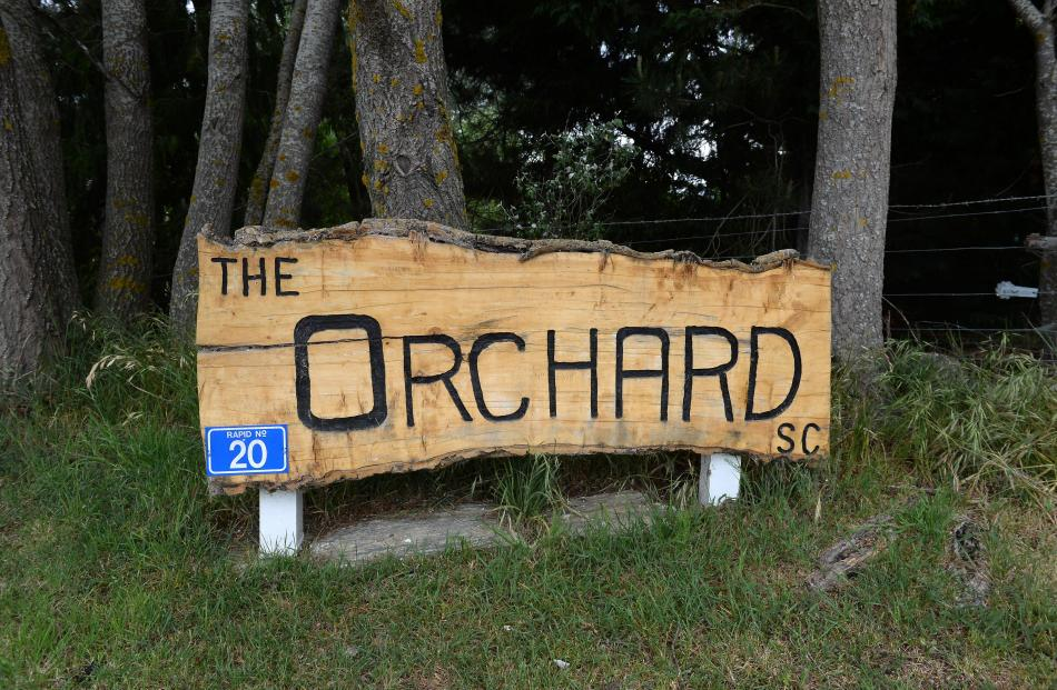 The sign at the entrance to the Orchard Sun Club.