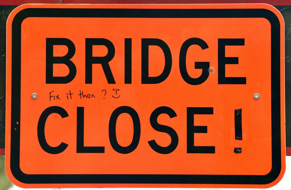 """The person also left a message on the """"bridge closed'' sign, asking the Dunedin City Council to fix the bridge."""