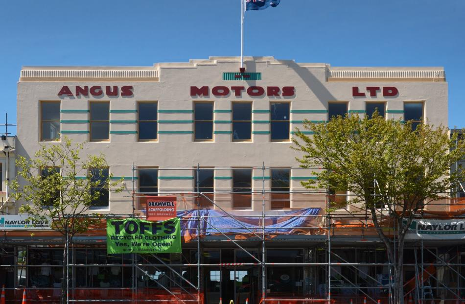 The startling restored facade of the Angus Motors building in Princes St. The facade had been covered with mirror glass.