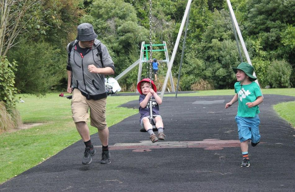 Samuel Rowse (6, right) and dad Andrew Rowse attempt to outrun Alexander Rowse (3) on the flying fox at Woodhaugh Gardens, Dunedin, on December 29. Photo: Susan Andrews