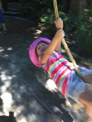 Sienna Trochon (3) loved the swing at the beautiful Chantecler Gardens just out of Queenstown on December 22.  Photo: Melissa Trochon