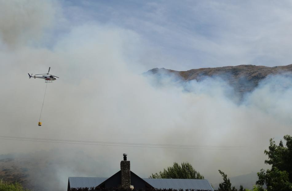 Despite the flames coming close to several houses, no buildings were damaged by the blaze. Photos: Sean Nugent