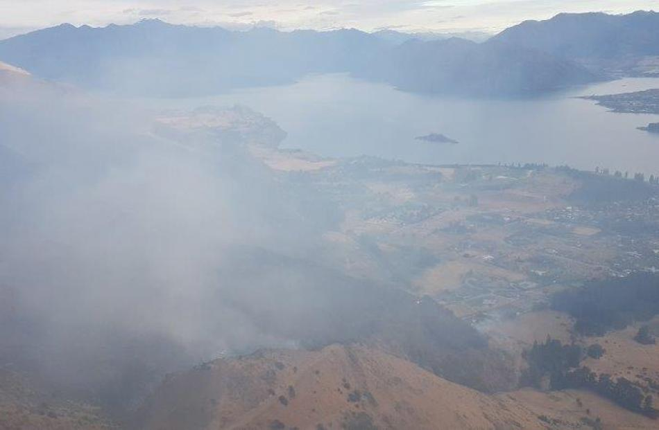 The smoke from the fire causes a haze over Wanaka this morning. Photo: Fire and Emergency New Zealand