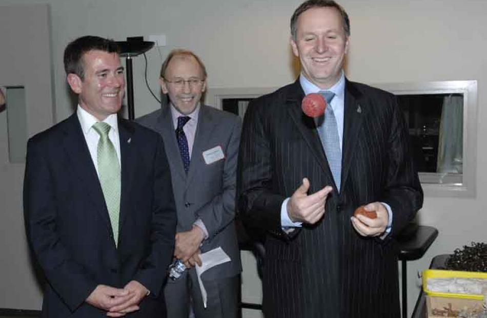 Prime Minister John Key demonstrates his juggling skills with a squelchy ball watched by (from...