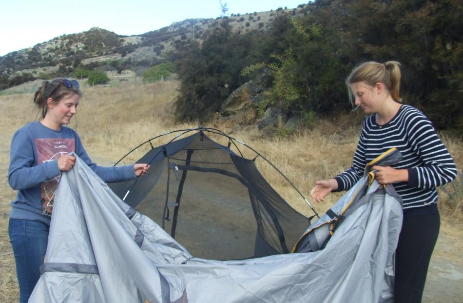 Setting up a home for the night are Katrin Schramm (left) and Alicia Altendeitering, both of...