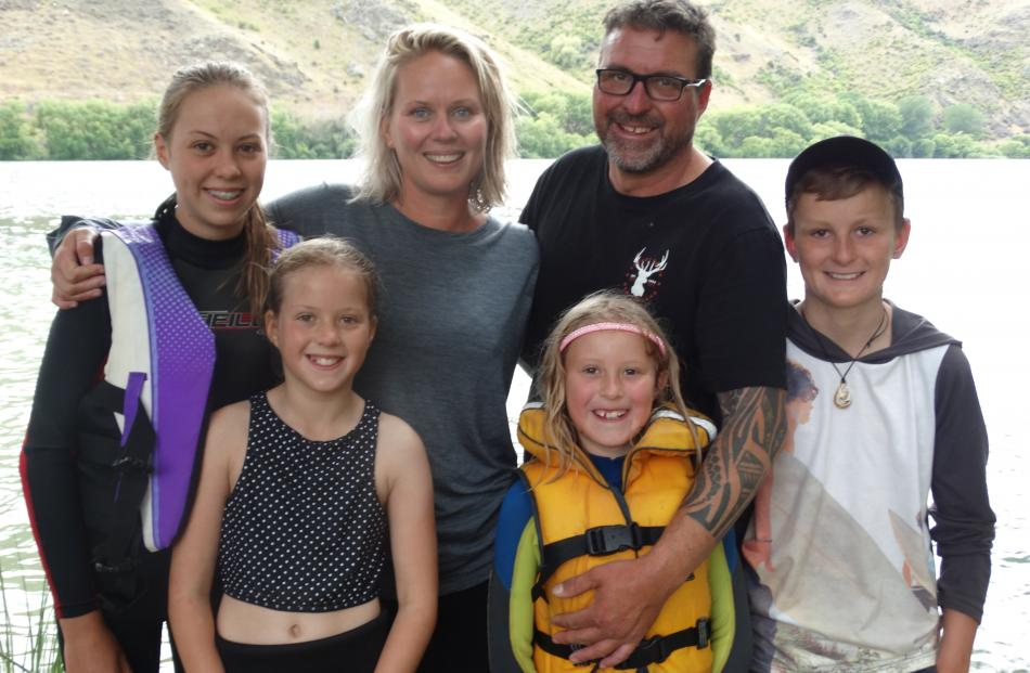 Lily (14, left), Macey (9), Amie, Kaiah (7), Nathan and Jai Rawson (12) at Parsons Rock camping...