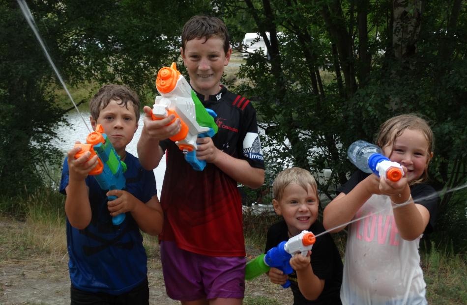 Alex Dally (7, left), Jacob Knoef (12), Harry Dally (5) and Jessica Stewart, all of Christchurch,...