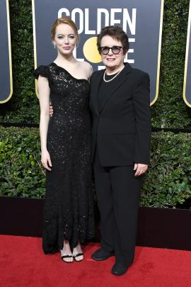 Emma Stone (left) in Louis Vuitton with tennis great Billie Jean King. Photo: Getty Images