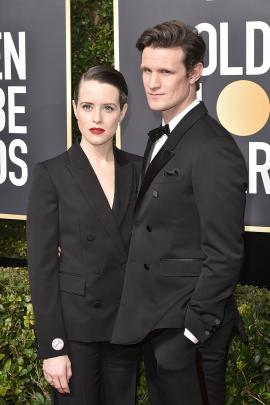 Claire Foy opted for a Stella McCartney tuxedo suit with Matt Smith, wearing Burberry. Photo:...