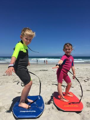 Matthew Hadley Storer (5) and Lucy Grace Storer (4) try out their Christmas gifts at St Kilda Beach, Dunedin, on December 28. Photo: Mel McAtamney