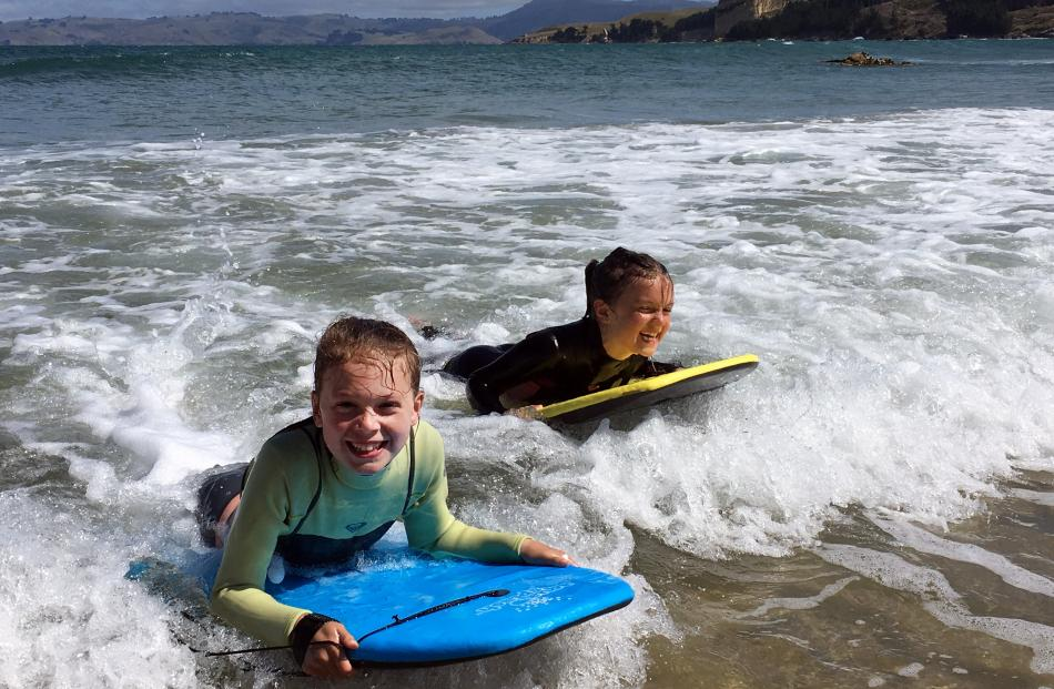 Annabel (11, left) and Isla (8) Ludgate enjoy their bodyboards in the surf at Karitane Beach, on a day trip up from their home in Dunedin. Photo: Jackie Ludgate