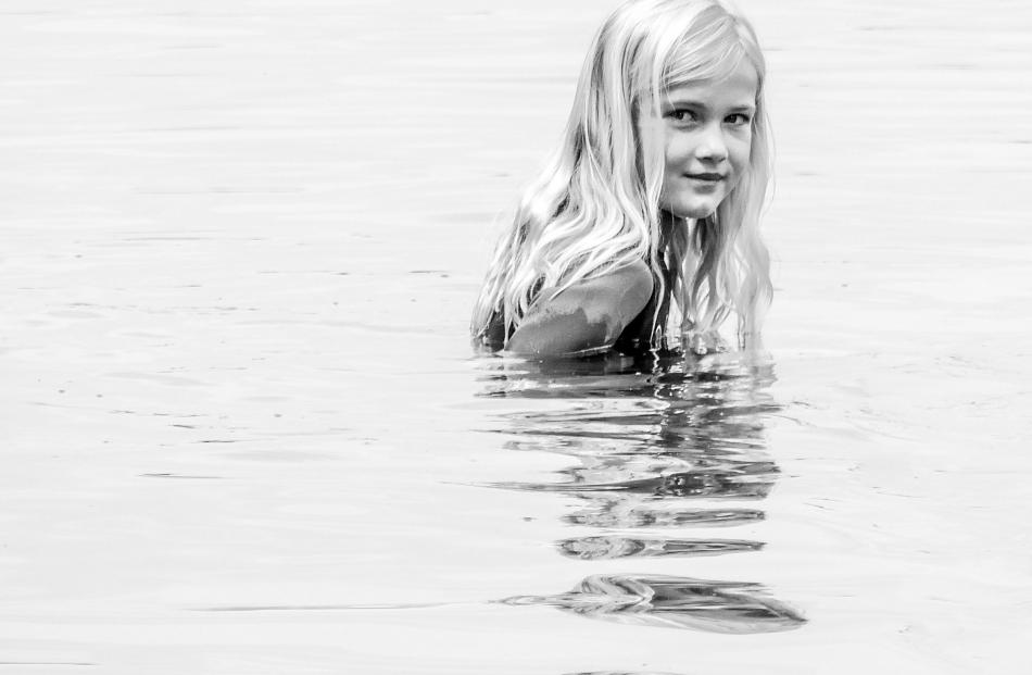Emily Aubin (8) takes a morning dip in the Naseby Swimming Dam. Photo: Melissa Purnell