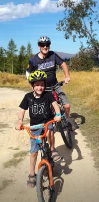 Murray McDowell and his grandson, Xavier Bristow (7), ride in the Naseby Forest. Photo: Sue McDowell