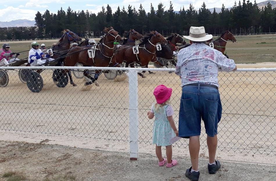 Payton McElrea (3) and her Pop, Barrie Keach, both of Balclutha, watch the horses at the Roxburgh...