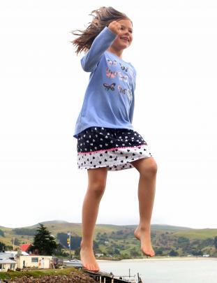 Cameron Walters (6) flies high on the trampoline at Harington Point last weekend. Photo: Martin Van Raalte