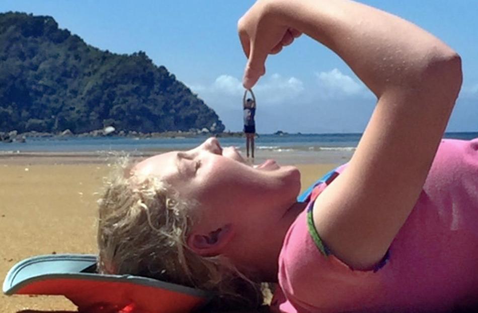 Hannah O'Neill (11) prepares to eat Josie O'Neill (10) at Abel Tasman Park on January 2. Photo: Adelle O'Neill