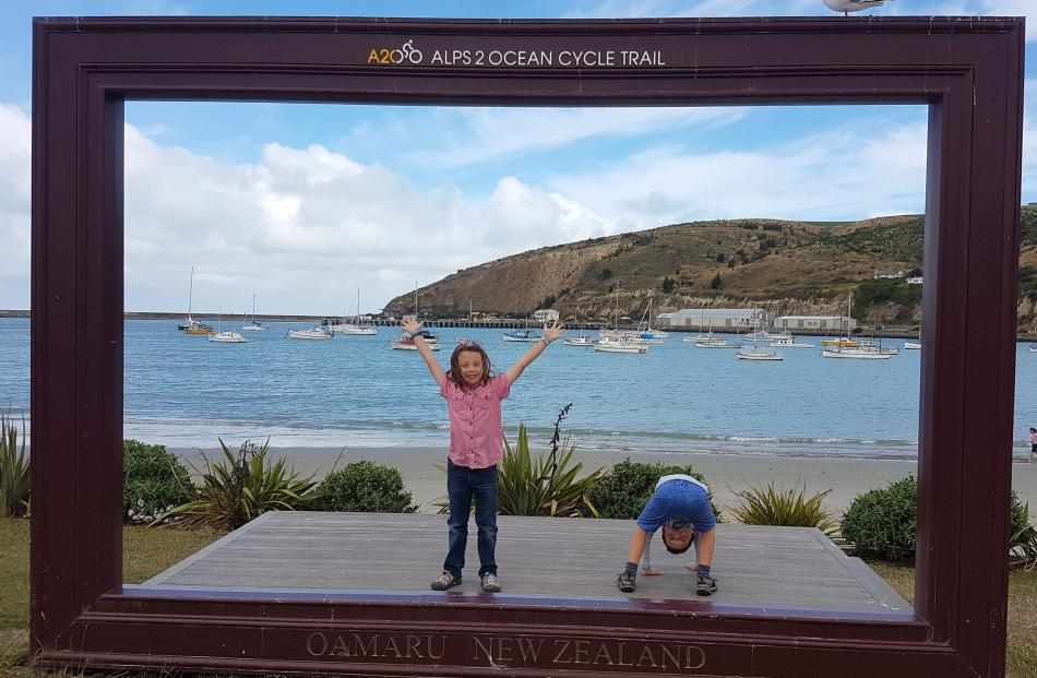 Sophie (8) and Liam (6) Drummond have fun in Oamaru on January 12. Photo: Kate Drummond