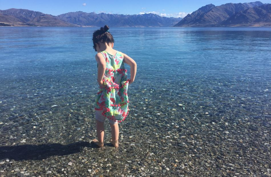 Libby Gordon (4) gingerly tests the water in Lake Hawea on  January 2. Photo: Jacqui Gordon