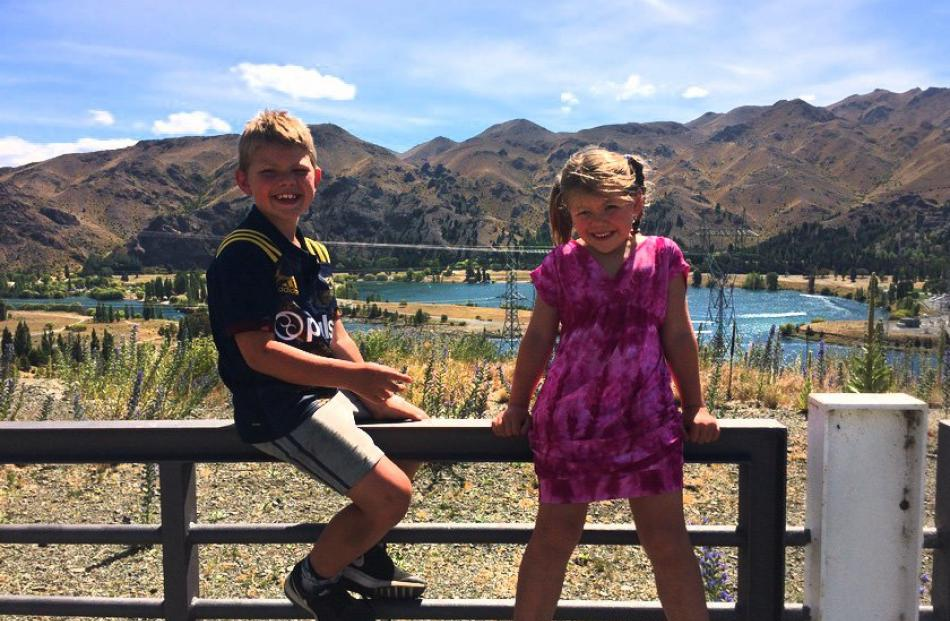Otis  (8) and Isla Murray (6) look over Loch Laird next to the spillway at Benmore Dam. Photo:...