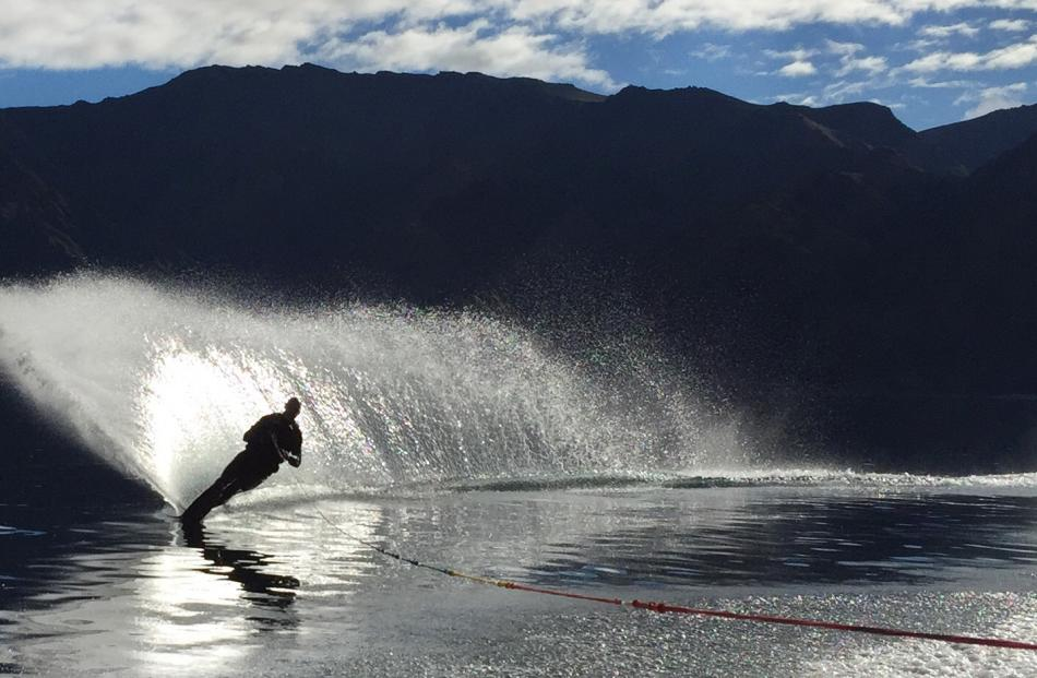 Mark Taylor (40) enjoys being the first water skier of the day on a very calm Lake Hawea on...
