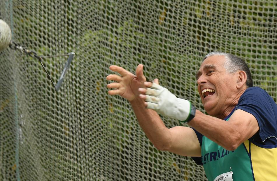 Didimo Tonelli, of Australia, lets go during the weight throw. PHOTOS: STEPHEN JAQUIERY